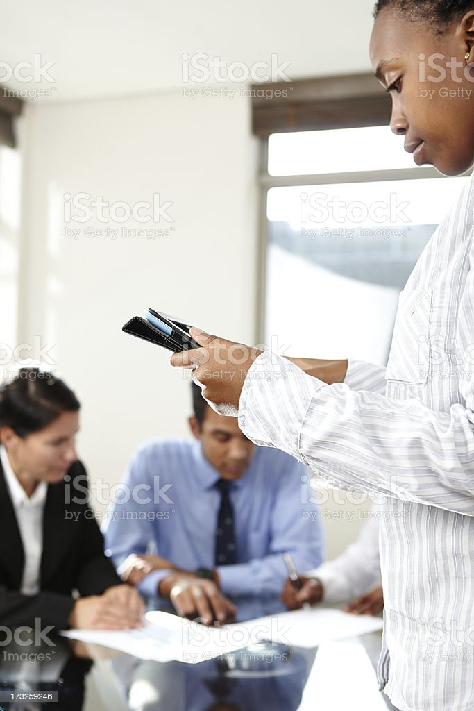 Business Woman check figures on tablet during a meeting royalty-free stock photo