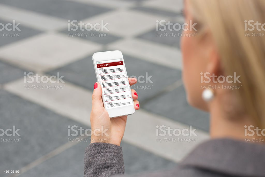 Business woman checking email on smartphone stock photo