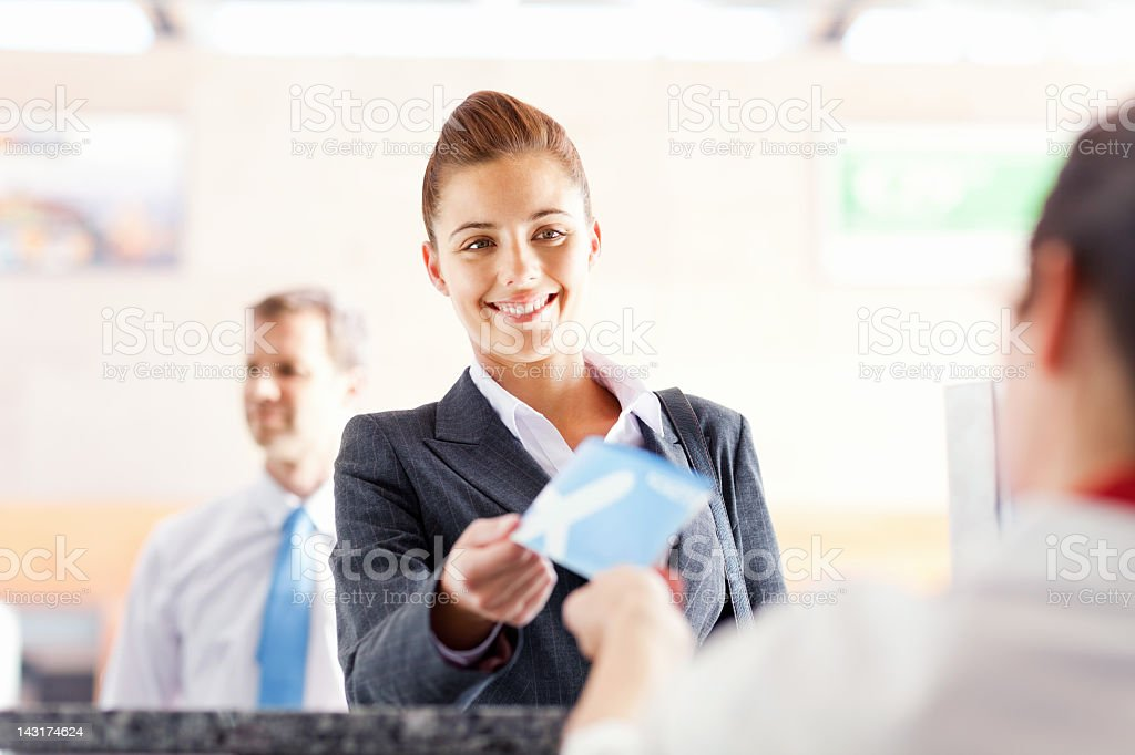 Business Woman Checking In At Airport stock photo