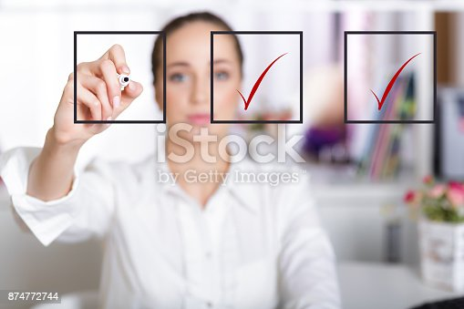istock business woman checking mark on checklist 874772744