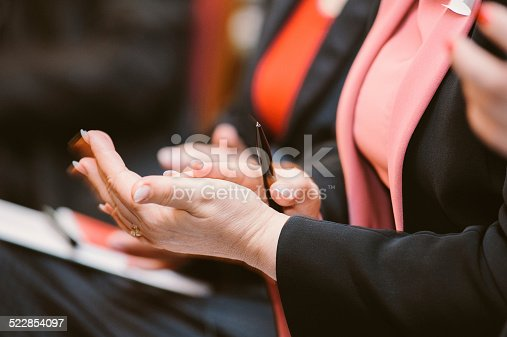 590048454 istock photo Business woman clapping hands applauding 522854097