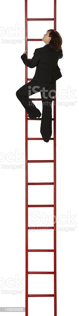 Business Woman Climbing the Ladder of Success stock photo