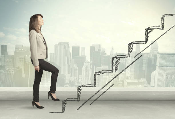 Business woman climbing up on hand drawn staircase concept Business woman climbing up on hand drawn staircase concept on city background development stock pictures, royalty-free photos & images