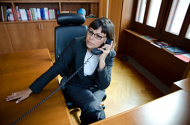 Business woman communication with the telephone stock photo