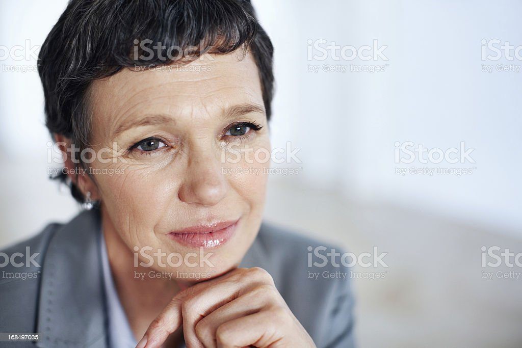Business woman contemplating royalty-free stock photo