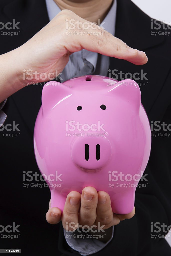 Business Woman Covering Piggy Bank royalty-free stock photo