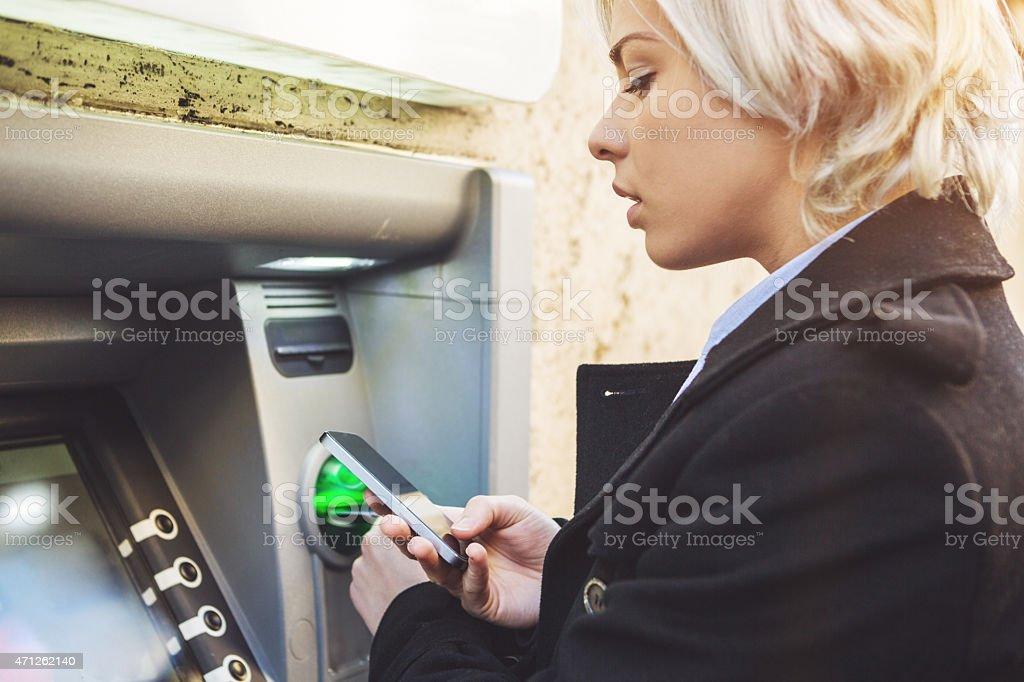 Business woman credit card withdrawal at bank stock photo
