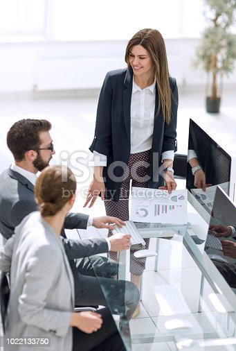istock business woman discusses with the business team financial performance 1022133750