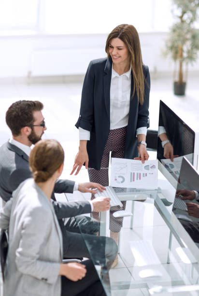 business woman discusses with the business team financial performance stock photo