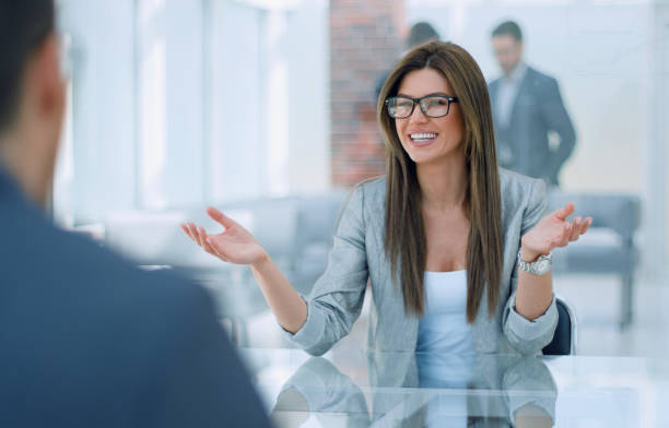 business woman discusses with the client the terms of the contract stock photo