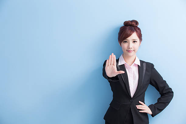 business woman do stop gesture business woman do a stop gesture with isolated on blue background, asian single word no stock pictures, royalty-free photos & images