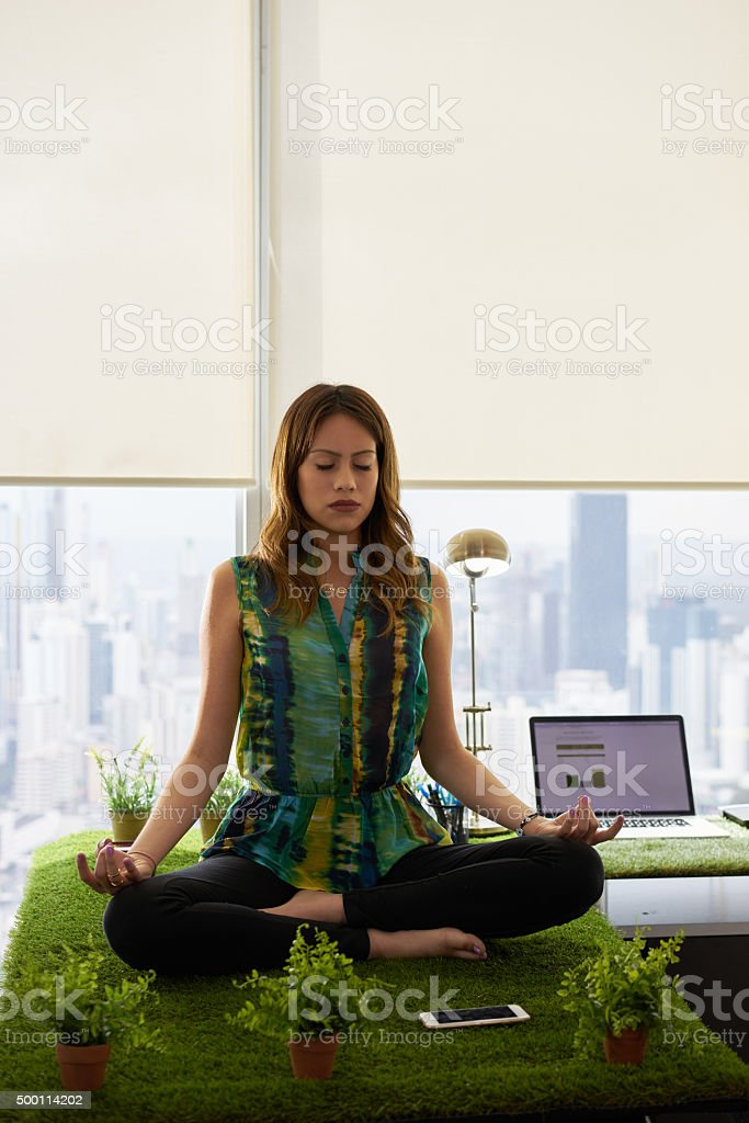 meditation in office. Business Woman Doing Yoga Meditation On Table In Office Royalty-free Stock Photo