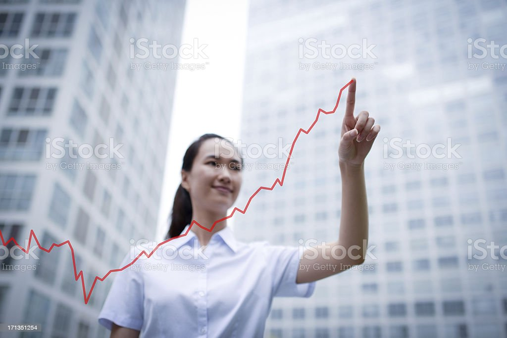 Business Woman Drawing a Growth Chart - XXXLarge royalty-free stock photo
