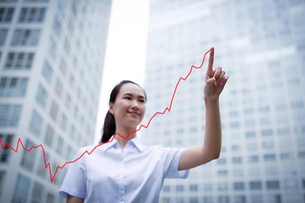 Business Woman Drawing a Growth Chart - XXXLarge stock photo