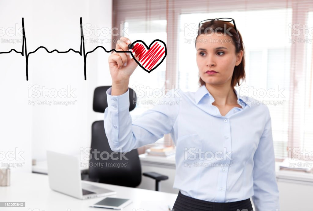 Business woman drawing a heartbeat royalty-free stock photo