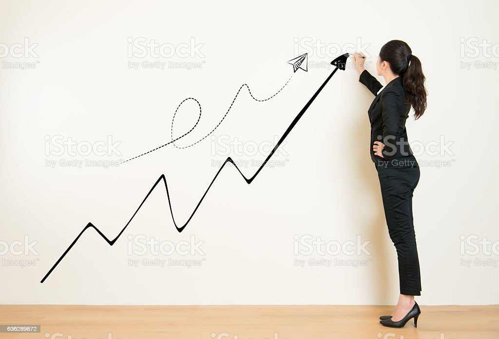 Business woman drawing graph showing profit growth stock photo