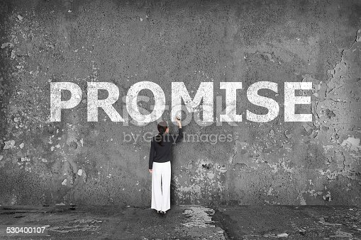 istock business woman drawing promise concept 530400107