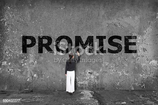 istock business woman drawing promise concept 530402277