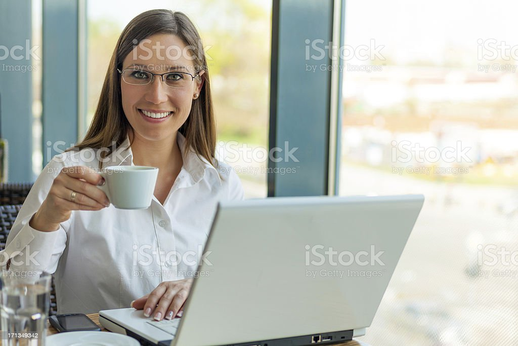 Business Woman Drinking Coffee with Laptop Computer royalty-free stock photo