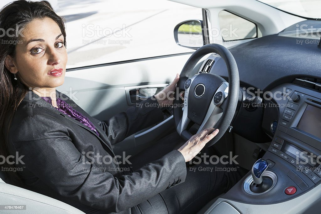 Business woman driving car stock photo