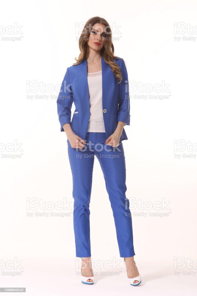 33408d0d078 Business woman executive posing in designer formal summer pink powder pant  suit - Stock image .