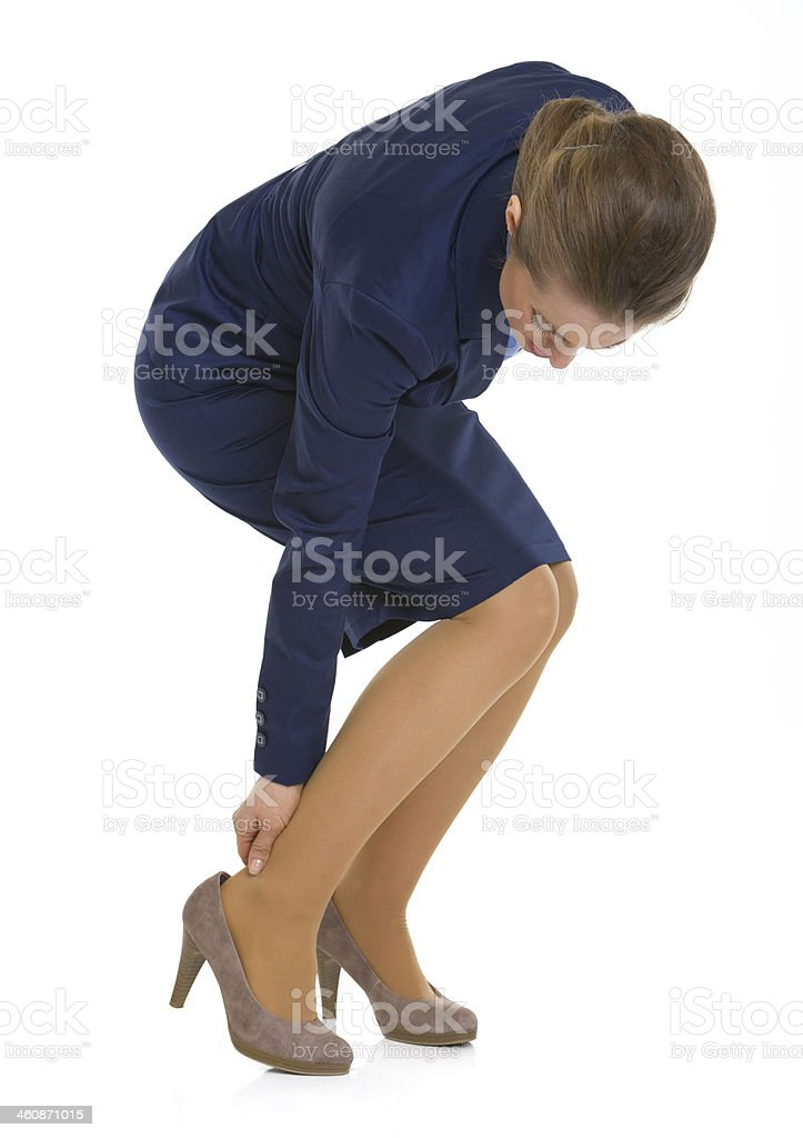 Business woman experiencing pain from shoes stock photo