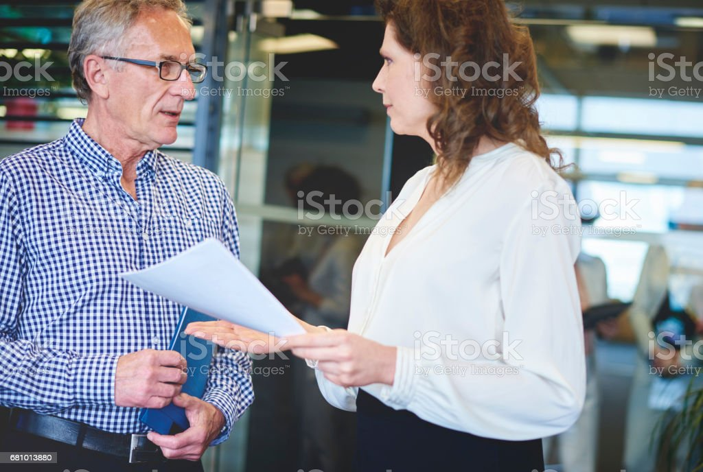 Business woman explaining project to colleague royalty-free stock photo