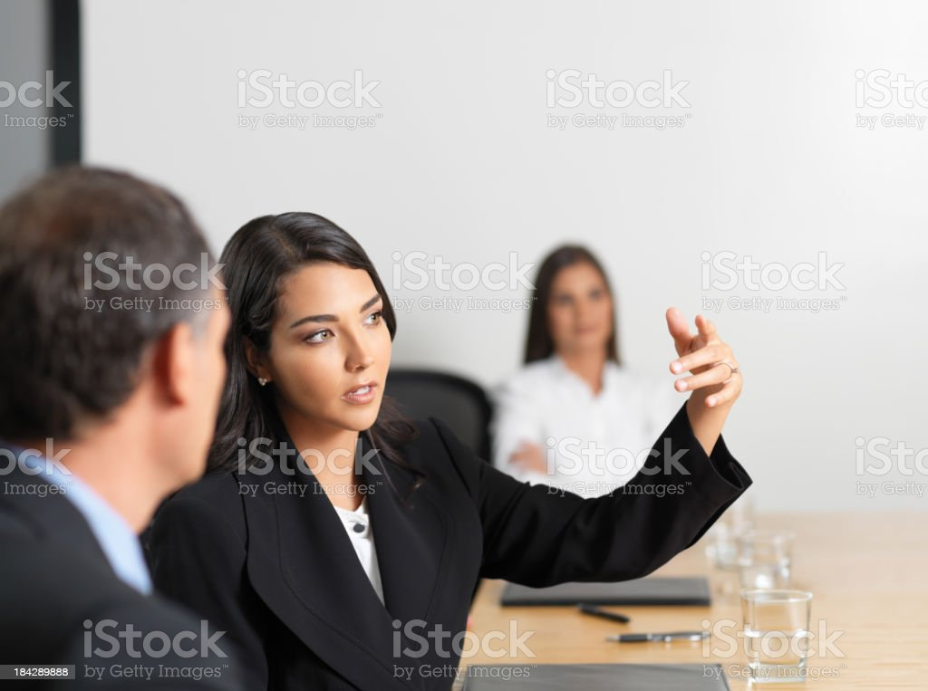 Business woman explaining to her colleague royalty-free stock photo