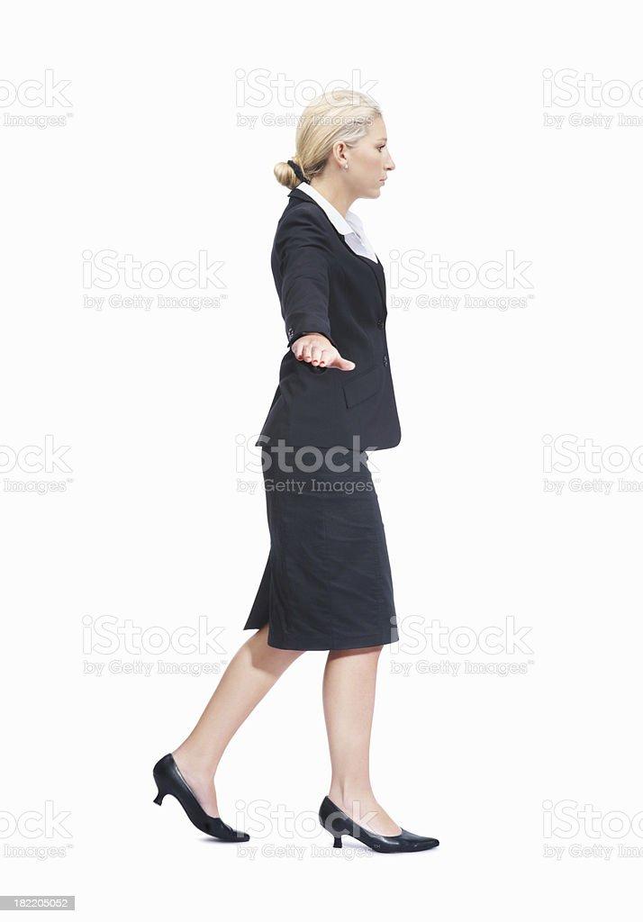 Business woman gesturing a balancing act stock photo