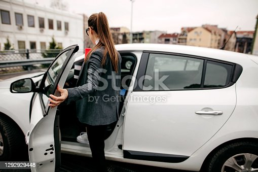 Business woman gets in her car