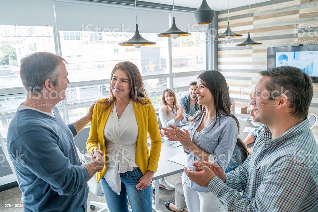 Business woman getting a promotion - foto de acervo