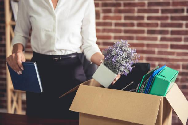business woman getting fired - oggetti personali foto e immagini stock