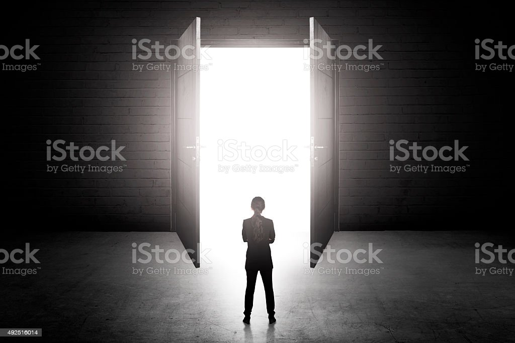 Business woman going to the open door stock photo