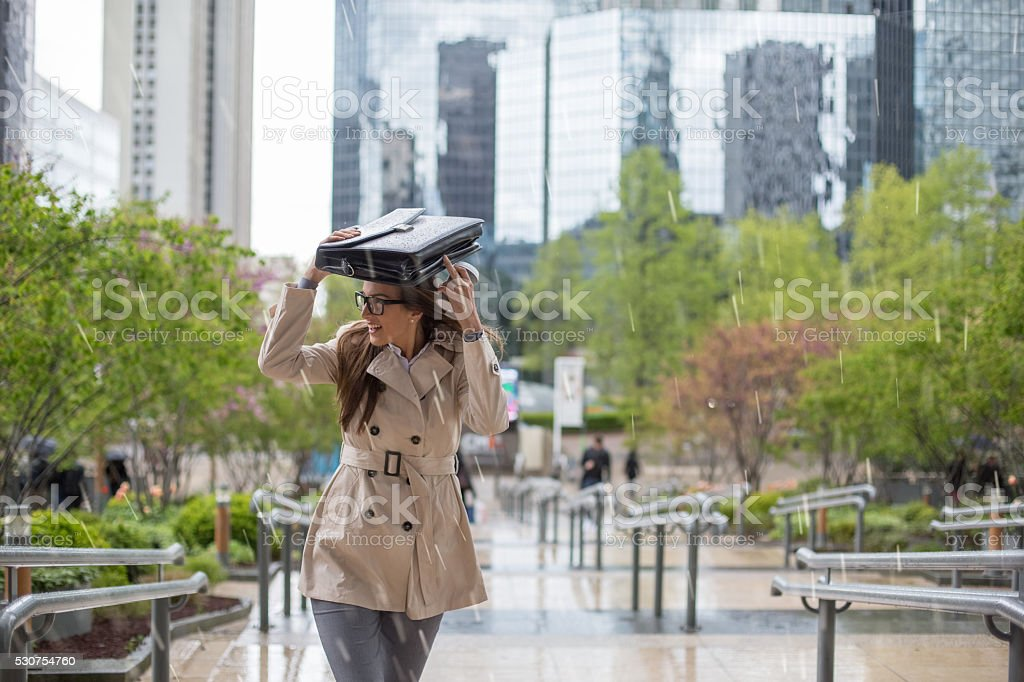 Business woman going to work on a rainy day stock photo