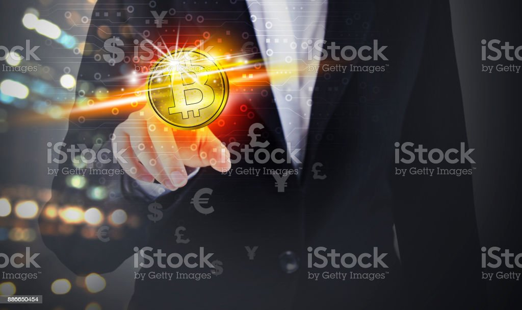 Business woman hand touching bitcoin and currency symbol stock photo