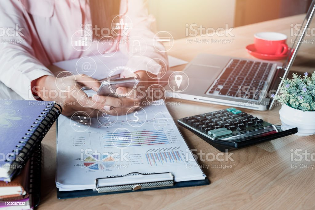 Business woman hand using smartphone with digital marketing via multi-channel communication network on mobile application technology. stock photo
