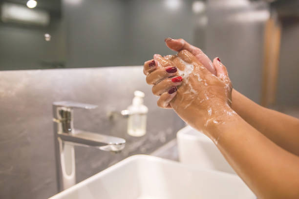 Business woman hand washing with soap to prevent Coronavirus stock photo
