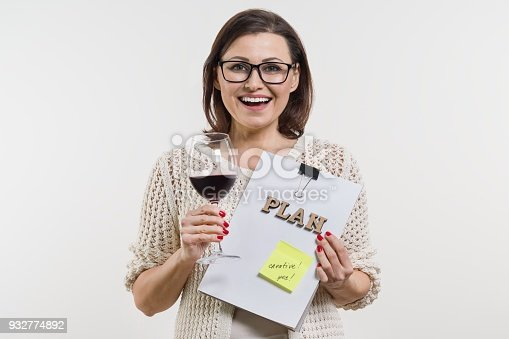 istock Business woman happy. Holds in the hands of the approved plan. 932774892