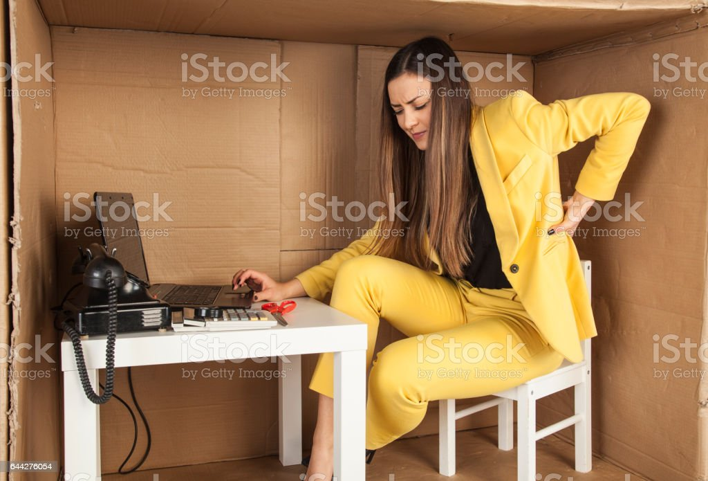 business woman has back pain from work stock photo