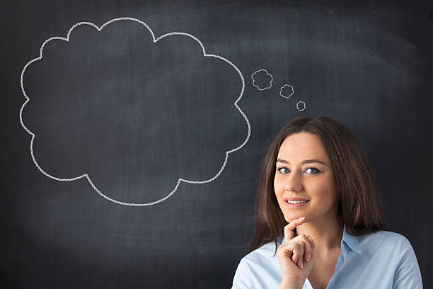 Business woman has something brilliant in mind Young woman think at a blank blackboard thought bubble stock pictures, royalty-free photos & images