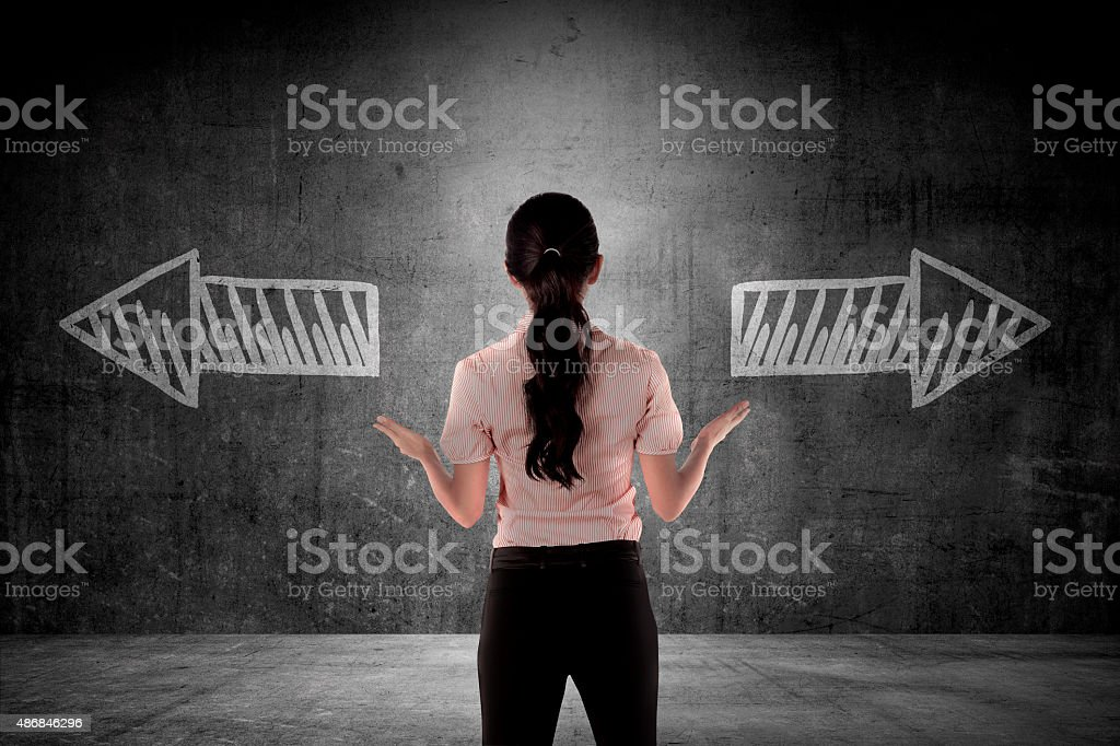Business woman has to choose between two way stock photo