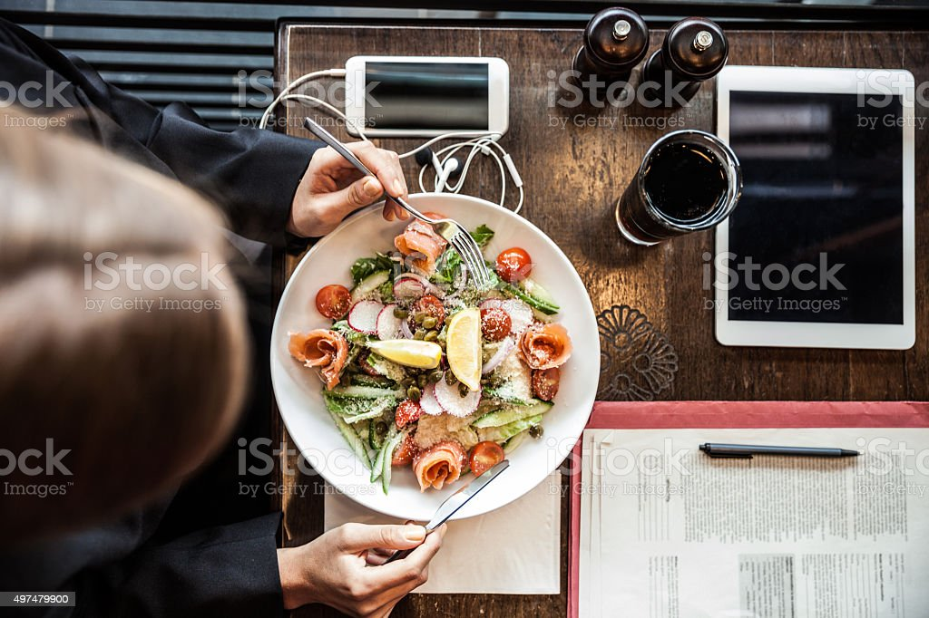 Business woman having a break in a restaurant stock photo