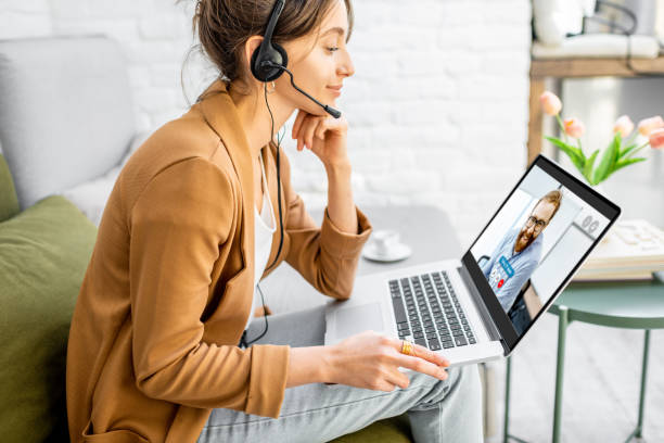Business woman having a video call with coworker stock photo