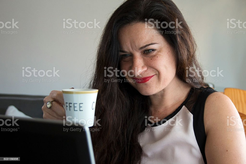 Business woman having coffee at home office stock photo