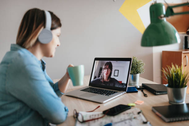 Business woman having online business meeting stock photo