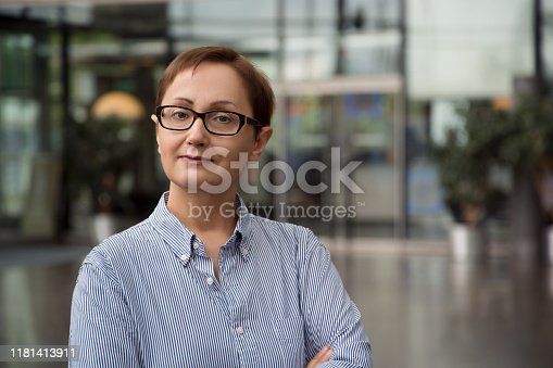 Professional portrait of middle aged lady 40 50 years old smiling and looking at the camera.