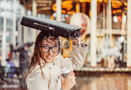 Young woman going to work on a rainy day