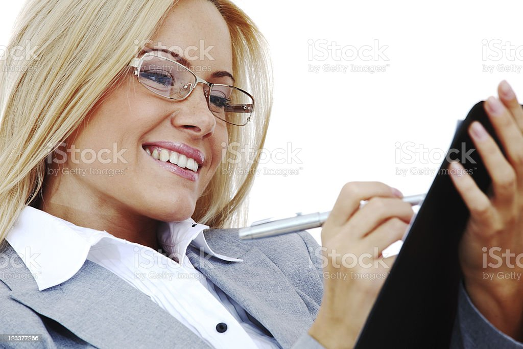 business woman hold a folder and write royalty-free stock photo