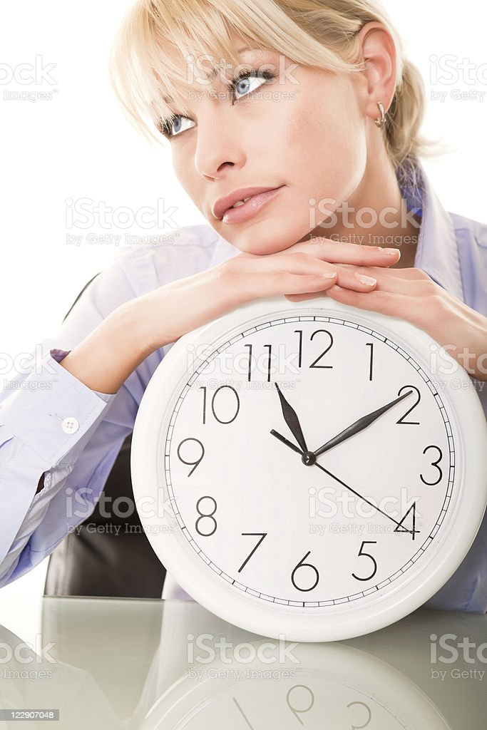 Business woman holding a clock royalty-free stock photo