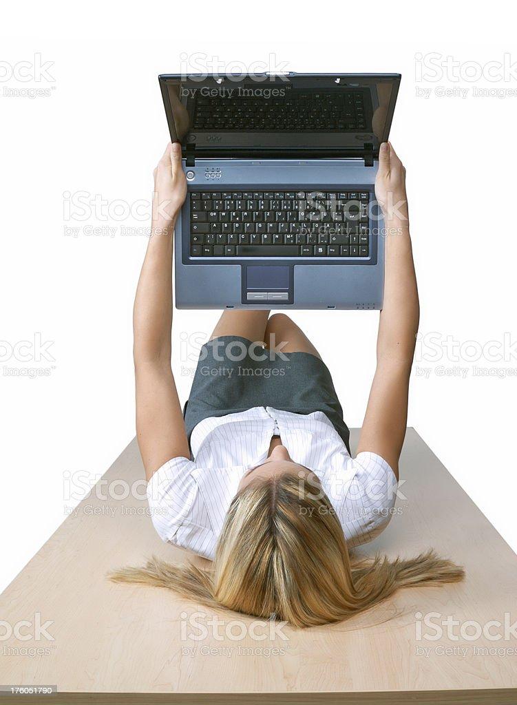 business woman holding a laptop aloft stock photo